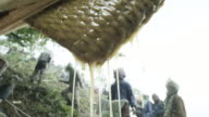 Honey drips from strainer, slow motion