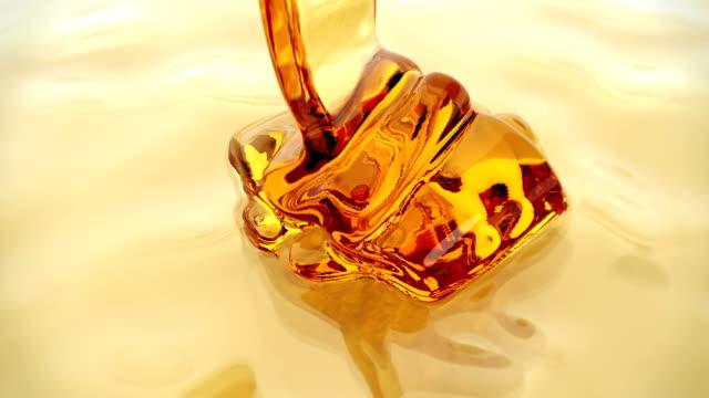 honey pour closeup background