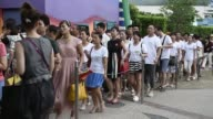 Hong Kong China on Wednesday July 29 2015 Shots Wide shot visitors walk through turnstiles to enter Ocean Park operated by Ocean Park Corp in Hong...
