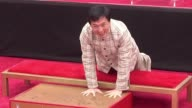 Hong Kong film star Jackie Chan became the first Chinese actor Thursday to have his hands and feet cast in wet cement at Hollywoods famed Chinese...