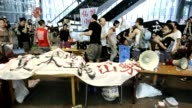 Hong Kong 'Occupy' protesters scuffled on September 11 2012 with bailiffs who evicted them from their camp underneath the Asian headquarters of HSBC...