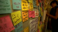 Prodemocracy protesters threaten to occupy more government buildings Umbrella drawn with chalk on road TILT UP protesters along Post it notes with...