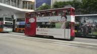 Hong Kong Trams in Central shopping district.