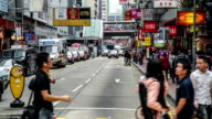 Hong Kong,China-Nov 13,2014: The traffic and pedestrians in the downtown of Kowloon in Hong Kong, China
