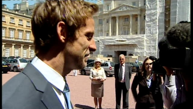 Buckingham Palace investiture ceremony Jenson Button and Patrick Stewart ENGLAND London Buckingham Palace EXT Jenson Button interview SOT describes...