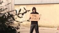 Hoody holding board saying 'THE FUTURE' - HD & PAL