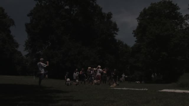 Eclipse watchers view totality from a backyard during the American total solar eclipse August 21 2017 in Hopkinsville Kentucky The small group reacts...