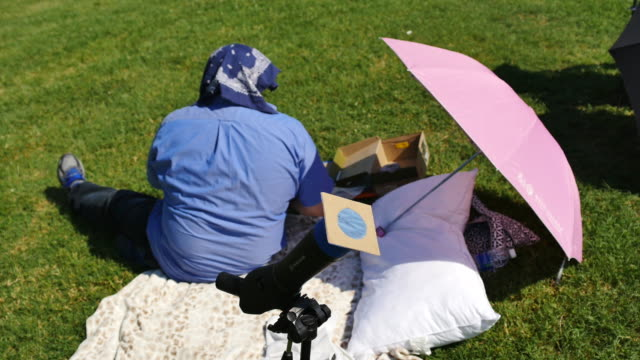 Eclipse watchers wait to watch a total solar eclipse's transit across the United States during the Great American Eclipse August 21 2017 at Little...