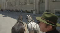POV WS horse drawn carriage moving through the historic center of Salzburg