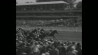 MS horses race off from starting line / horses racing past stands / horses race past landscaped grounds / King George V Queen Mary Queen Alexandra...