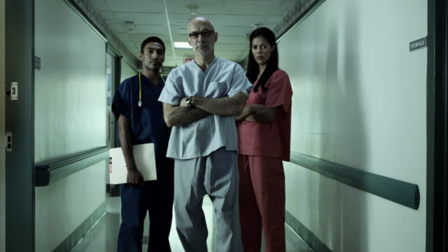 Hospital staff standing in hospital corridor