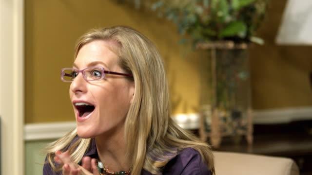 CU Hostess talking to off-camera guest, Dallas, Texas, USA