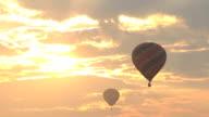 hot air balloon flying at sunrise