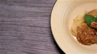 Hot Apple Crumble Panning On Wood Background