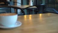 hot caramel macchiato in cafe