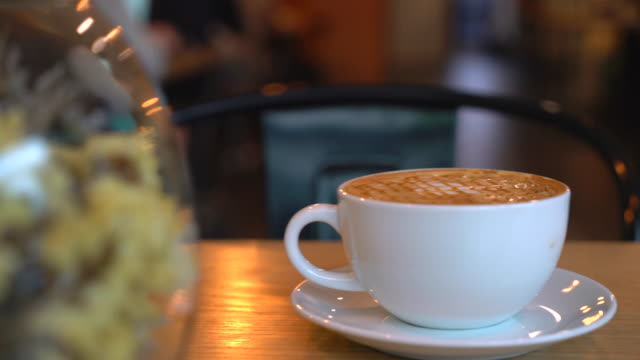 hot caramel macchiato in cafe