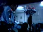 Hot coals burn as men smoke shisha pipe at outdoor cafe Dubai