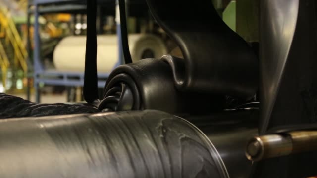Hot rubber is poured on the production line inside the Vsevolozhsk tyre manufacturing plant operated by Nokian Renkaat Oyj in Vsevolozhsk near St...
