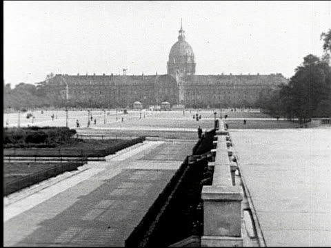 Hotel des Invalides old soldiers home dome Champs Elysees avenue street boulevard cars automobiles traffic pedestrians French Parisian bicyclist...