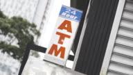 24 hour ATM establishing shot in New York City