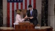 House Minority Leader Nancy Pelosi of California concludes her address the House handing House Speaker Paul Ryan of Wisconsin the gavel thanking...