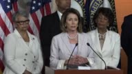 House Minority Leader Nancy Pelosi of California feels questions from reporters at a press conference with House Democrats about questionable...