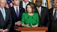 House Minority Leader Nancy Pelosi of California is joined by members of the caucus in the House studio for a press briefing minutes after...