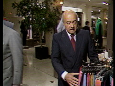 Referral refused ITN ENGLAND London Knightsbridge Harrods FORWARD as Mohammed Al Fayed up To tie rack and inspects TRACK ROUND ITN SCOTLAND Glasgow...