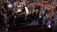 House Sergeant at Arms Paul Irving announces the arrival of members of the United States Senate who file into the house chamber down the Senate aisle...