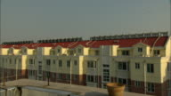 WS House with row of solar water heaters on roof, Dezhou, Shandong, China