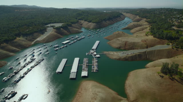 Houseboats anchored along Bidwell Canyon Marina on Lake Oroville, California.