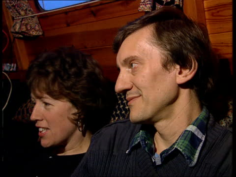 Houseboats MUSIC MS Couple inside their houseboat TMS Man getting something out of cupboard CMS Peter and Anne intvwd SOF We could be made homeless...
