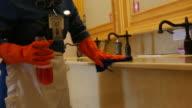 housekeeper cleaning bathroom