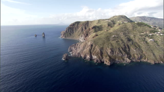 Houses and farms dot the rugged coastline of Sicily. Available in HD.