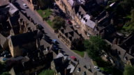 Houses and shops line a city street in Scotland. Available in HD.