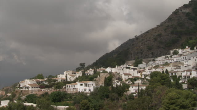 Houses cover the base of a mountain in Andalusia, Spain.