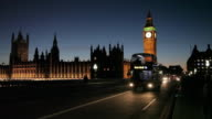 Houses of Parliament and Big Ben Clocktower, Westminster Brdge Buses at Dusk, Westminster, London, England, UK