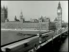 Houses of Parliament Clock tower housing Big Ben Westminster Bridge w/ traffic cars doubledecker buses FG