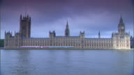 TU WS Houses of Parliament on north bank of River Thames w/ Victoria Tower Clock Tower housing Great Bell Big Ben sunlight on Tower building fades