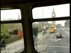 Houses of Parliament silhouetted against bright sky LS Parliament seen across Thames as sun low in sky Parliament seen thru window as bus along...