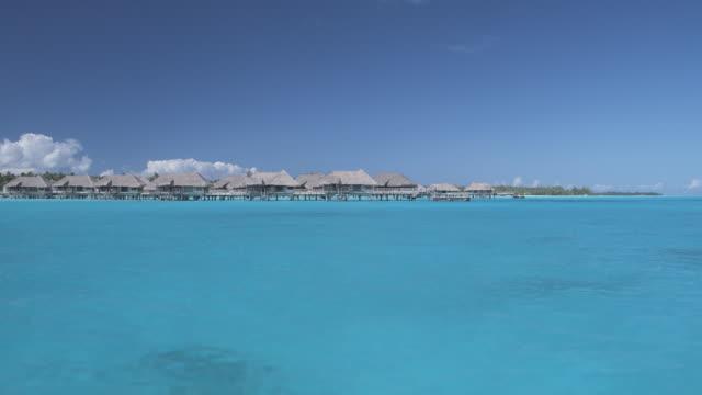 T/L WS POV MS Houses on stilts in tropical lagoon, Bora Bora, Society Islands, French Polynesia