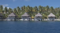 MS ZI Houses on stilts in tropical lagoon, Bora Bora, Society Islands, French Polynesia