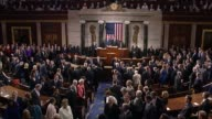 Houses SergeantatArms Paul D Irving announces the entrance of the Pontiff to the House chamber Pope Francis approaches the dais shakes hands with...