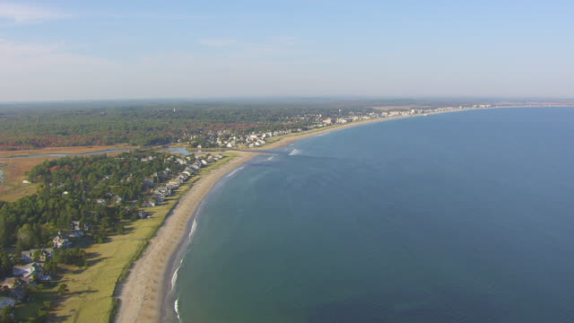 WS AERIAL POV Houses View of sea with beach, houses with forest area / Old Orchard Beach, York County, Maine, United States