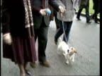 London St James Pk MS Sir Geoffrey and Lady Howe walking with dog in park TILT to dog at walk towards Downing St CMS Howe with Budget box wife in b/g...