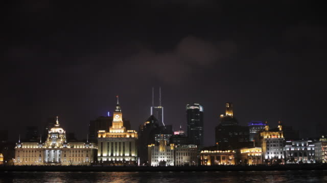 WS Huangpu River and The Bund skyline with at night / Shanghai, China