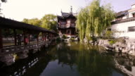 Huangpu, Yu Yuan Garden, Dianchun Hall, pond, bridge, trees, rocks, Shanghai, China