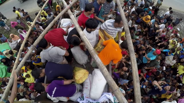 Huge crowds of Rohingya refugees receiving food handouts from local Bangladeshi people