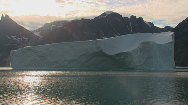 Huge iceberg floating in a fjord in Greenland
