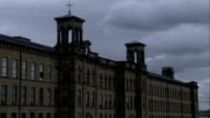 A huge textile mill towers in Saltaire, England. Available in HD.